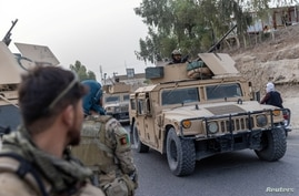 A convoy of Afghan Special Forces is seen during the rescue mission of a police officer besieged at a check post surrounded by Taliban, in Kandahar province