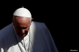 FILE PHOTO: Pope Francis walks after the weekly general audience at the Vatican