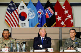 U.S. President Donald Trump receives a briefing from military commanders at the U.S. Eighth Army Operation Command Center at U…