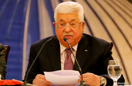 FILE PHOTO: Palestinian President Mahmoud Abbas delivers a speech following the announcement by the U.S. President Donald Trump…