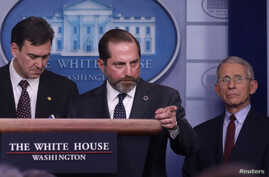 United States Secretary of Health and Human Services Secretary Alex Azar is flanked by Joel Szabat, acting under secretary for…
