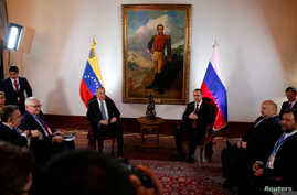 Russia's Foreign Minister Sergey Lavrov and his Venezuelan counterpart Jorge Arreaza attend a meeting Caracas, Venezuela…