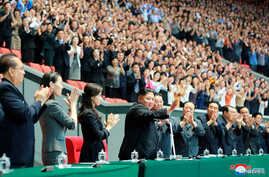 North Korean leader Kim Jong Un and his wife Ri Sol Ju watch the grand gymnastics and artistic performance, North Korea, in…