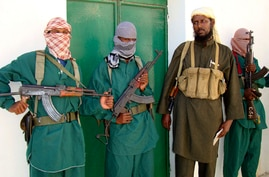 Sheik Muktar Robow Abu Mansur (2nd R), spokesman of Somalia's Islamic al-Shabab, leaves a news conference after vowing to step…