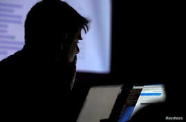 A man takes part in a hacking contest during the Def Con hacker convention in Las Vegas, Nevada, U.S. on July 29, 2017. REUTERS…