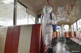A trolley bus is disinfected amid fears over the spread of the novel coronavirus in Pyongyang, North Korea, in this photo taken…
