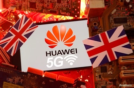 FILE PHOTO: The British flag and a smartphone with a Huawei and 5G network logo are seen on a PC motherboard in this…