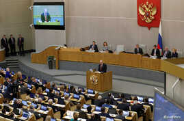 Russia's President Vladimir Putin delivers a speech during a session of the lower house of parliament to consider…