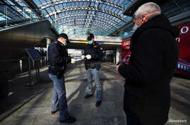 Police officers check a passenger's documents at Torino Porta Susa railway station, after a decree orders for the whole of…