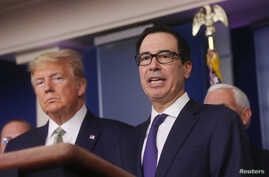 U.S. President Donald Trump and Treasury Secretary Steven Mnuchin answer questions during the Trump administration?s daily…