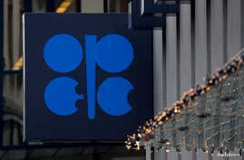 The logo of the Organisation of the Petroleum Exporting Countries (OPEC) sits outside its headquarters ahead of the OPEC and…