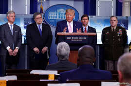 U.S. President Donald Trump addresses the daily coronavirus response briefing as National Security Advisor Robert O'Brien,…