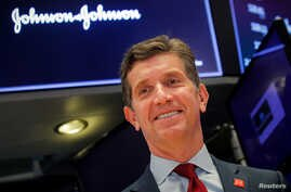 Alex Gorsky, Chairman and CEO of Johnson & Johnson, celebrates the 75th anniversary of his company's listing on the floor at…