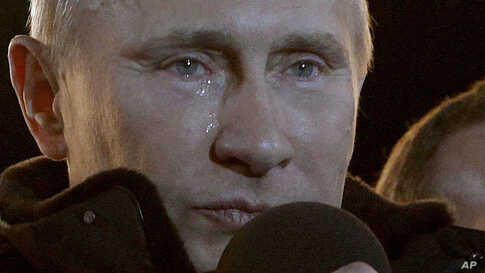 Russian Prime Minister Vladimir Putin who claimed victory in Russia's presidential election, has tears in his eyes at a massive rally of his supporters at Manezh square outside Kremlin, in Moscow, Russia March 4, 2012. (AP)