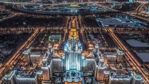 An aerial view taken with a drone in Moscow on January 27, 2018 shows the main building of the Moscow State University, Luzhniki Stadium and the Moskva River.