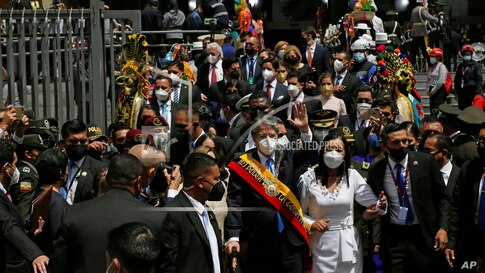 Ecuador's new President Guillermo Lasso wears the presidential sash after his inauguration ceremony as he exits the National…