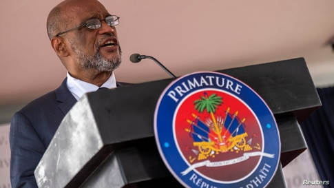 Designated Prime Minister Ariel Henry speaks during his appointment ceremony as the new Prime Minister at La Primature in Port…