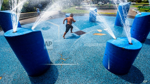 Jose DeJesus, 6, cools off at the Farnham park fountains, Friday, July 16, 2021, in Camden, N.J. (Jose F. Moreno/The…