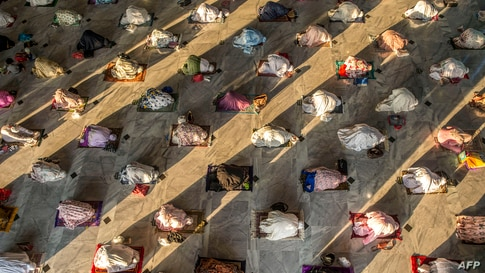 TOPSHOT - Muslims attend Eid al-Adha prayers with social distancing as a preventive measure against the COVID-19 coronavirus at…