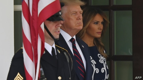 US President Donald Trump and First Lady Melania Trump wait to welcome the arrival of Prime Minister of Israel Benjamin…