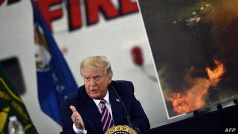 TOPSHOT - US President Donald Trump speaks during a briefing on wildfires with local and federal fire and emergency officials…