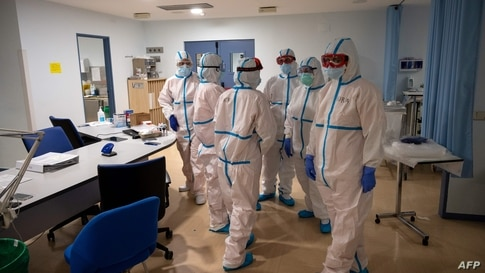 Healthcare workers chat at the Intensive Care Unit (ICU) of the Severo Ochoa University Hospital in Leganes on October 16, 2020…