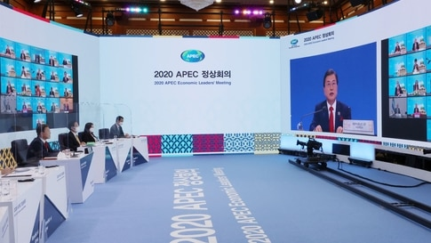South Korean President Moon Jae-in (L) speaks during a virtual summit with leaders of the Asia-Pacific Economic Cooperation …