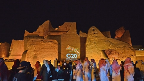 The G20 logo is projected at the historical site of al-Tarif in Diriyah district, on the outskirts of Saudi capital Riyadh, on…