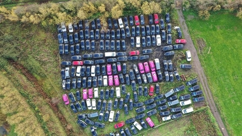 TOPSHOT - An aerial view shows black London taxi cabs parked up in a field in Epping, north-east of London on November 19, 2020…