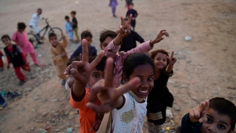 Children play in a ground during the World Children's Day in Karachi on November 20, 2020. (Photo by Asif HASSAN / AFP)