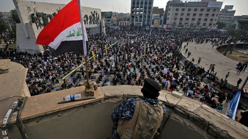 Supporters of Iraq's Shiite cleric Moqtada al-Sadr perform the noon Friday prayer in Tahrir Square in Baghdad on November 27,…