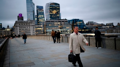 A pedestrian walks over London Bridge away from the City of London in London on November 25, 2020. - Britain's economy is set…