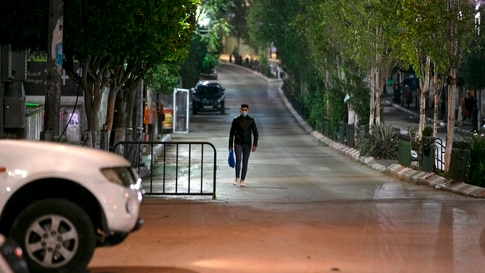 A Palestinian walks in a deserted street in the West Bank city of Ramallah on November 27, 2020, amid a 48-hour lockdown due to…