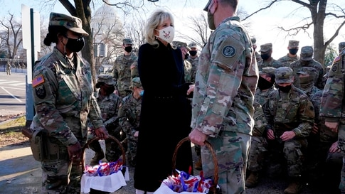 US First Lady Jill Biden surprises National Guard members outside the Capitol with chocolate chip cookies on January 22, 2021,…