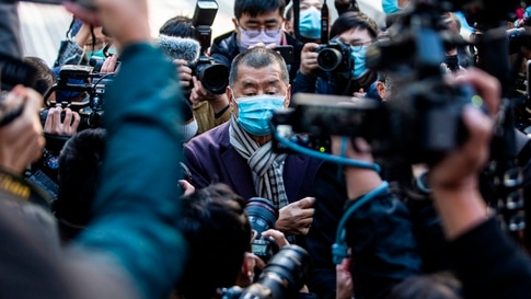TOPSHOT - Hong Kong pro-democracy media tycoon Jimmy Lai (C) arrives at the Court of Final Appeal in Hong Kong on December 31,…