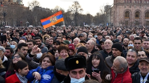 TOPSHOT - Supporters of Prime Minister Nikol Pashinyan gather to listen to his speech at Republic Square in downtown Yerevan on…