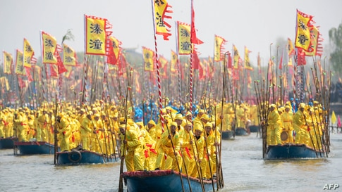 TOPSHOT - This photo taken on April 8, 2021 shows boats taking part in a performance during the Qintong boat festival in…