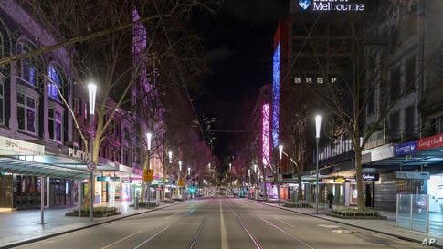 An empty Swanston Street is seen at night in the Central Business District as lockdown due to the continuing spread of COVID-19…