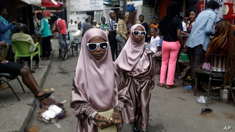 Muslim girls are seen after prayers, in Lagos, Nigeria, Friday, July 31, 2020. Small groups of pilgrims performed one of the…