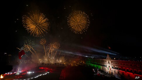 Fireworks go off in front of Metropolitan Cathedral after Mexican President Andres Manuel Lopez Obrador gave the annual…