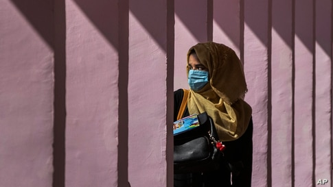 A Kashmiri student wearing face mask arrives at a school in Srinagar, Indian controlled Kashmir, Monday, Sept. 21, 2020…