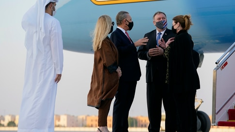 Secretary of State Mike Pompeo, second from right, and his wife Susan, right, speak with U.S. Ambassador to the United Arab…