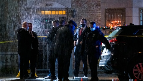 Police investigate the scene where a New York City police officer was shot during an incident in the Crown Heights section of…