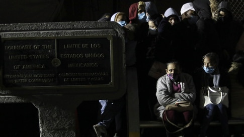 Migrants, mainly from Cuba, occupy the Mexican side of the Paso del Norte border bridge, where a plaque marks the border line,…