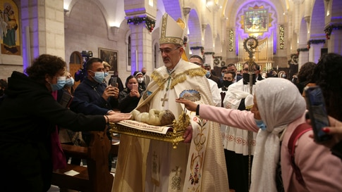 Apostolic Administrator of the Latin Church in the Holy land Pierbattista Pizzaballa, center, leads a Christmas midnight mass…