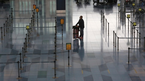A departure lobby of Haneda International Airport is quiet due to the coronavirus outbreak in Tokyo, Monday, Dec. 28, 2020. (AP…