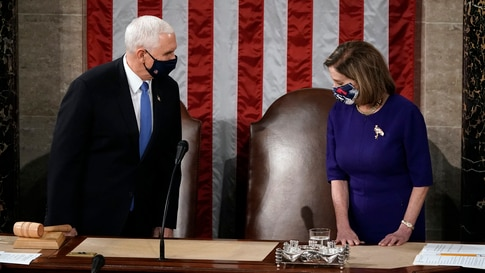 Speaker of the House Nancy Pelosi, D-Calif., and Vice President Mike Pence arrive to officiate as a joint session of the House…