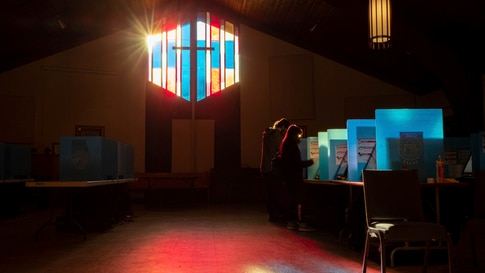 Voters mark their ballots at the Lawrenceville Road United Methodist Church in Tucker, Ga. during the Senate runoff election…