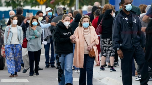 People arrive at Jackson Memorial Hospital to receive the COVID-19 vaccine, Wednesday, Jan. 6, 2021, in Miami. The push to…