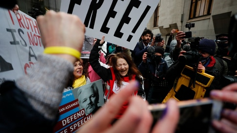 Julian Assange supporters celebrate after a ruling that he cannot be extradited to the United States, outside the Old Bailey in…